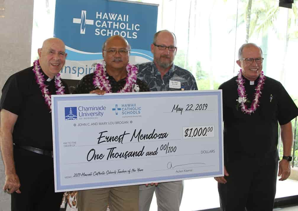 Ernest Mendoza accepting his check for Hawaii Catholic Schools teacher of the year