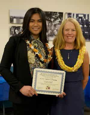Chloe Talana receiving the Sue Wesselkemper Award during Na Liko Na'auao