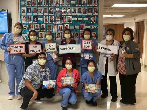 Queen's Medical Center's nurses and staff saying thank you to the HOSA Club for the care package donation