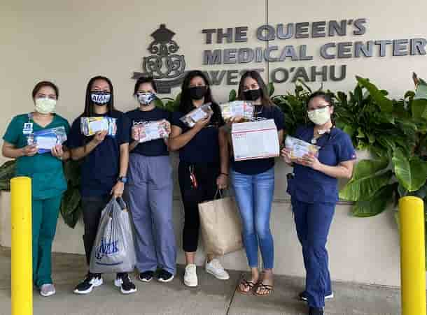 Chaminade's HOSA Club delivering care packages to Queen's Medical Center