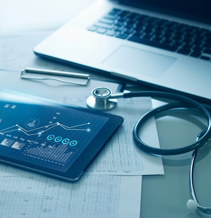 Healthcare business concept, Medical examination and graph data growth of business on tablet with doctor's health report clipboard on background. (Healthcare business concept, Medical examination and graph data growth of business on tablet with doctor