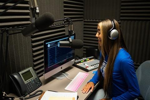 Student Ronni Gallegos in the Radio CUH studio