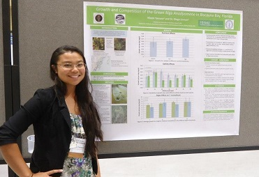 Nicole Yamase '14 showcasing her research at Chaminade's event in 2012
