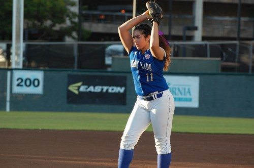 Luana Moreno, BA Religious Studies '17, playing softball for Chaminade