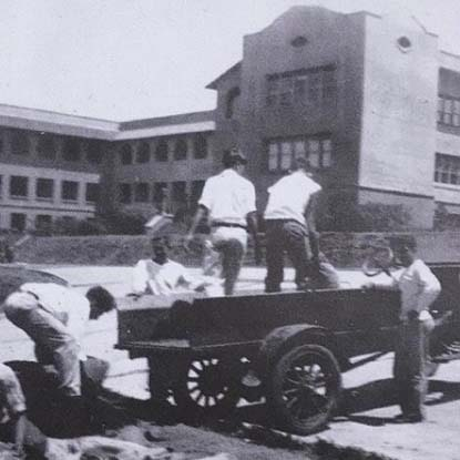 historic photo of construction workers at Chaminade University