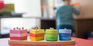 Wooden colorful Montessori toys and child is back