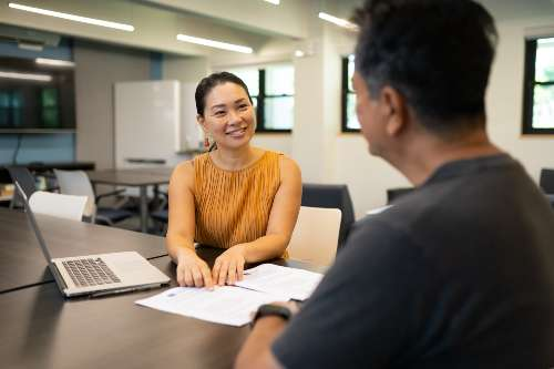 an online undergraduate student meets his advisor in-person to review his academic plan